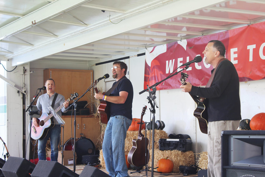 Pennies on the Track perform while residents sip on cider.