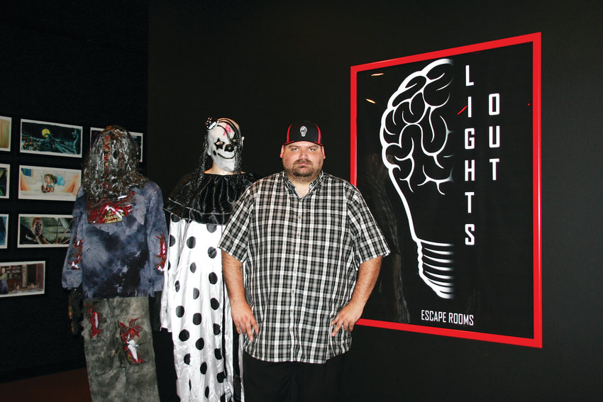 James Goodchild stands at the entrance of Lights Out! Escape Rooms and Social Lounge. Although horror-themed, the venue is not a haunted house and emphasis is put on solving the puzzles, rather than scare factor.