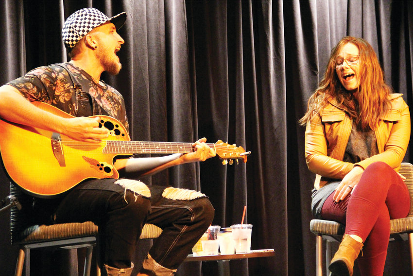 On left, Kendall James performs on stage with his wife, Elizabeth Frances, Oct. 3 at The Forum Theater in Koelbel Library in Centennial. The duo performed about two hours of original music — with a few covers peppered in.
