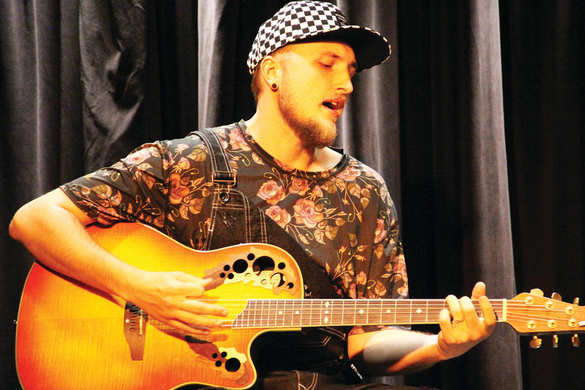 Kendall James, 27, of Parker, performs on stage Oct. 3 at The Forum Theater in Koelbel Library in Centennial. James performed about two hours of original music — with a few covers peppered in — with his wife, Elizabeth Frances.