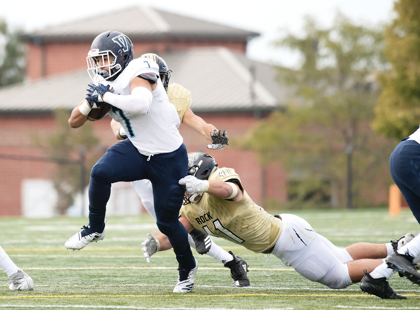 Rock Canyon's Caleb Hefner tries to get a hand on Valor Christian's Joshia Davis. Valor defeated the Jaguars 42-0 on Oct. 6 at Shea Stadium.