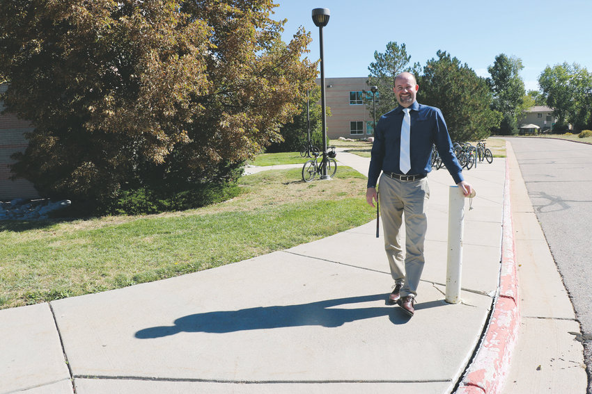 Tanner Fitch, principal of Ranch View Middle School in Highlands Ranch, stands in front of his building. Some of the school's sidewalks are cracked and in need of repairs.