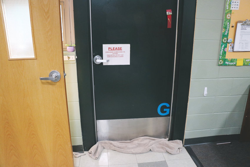 Teachers use towels to keep rainwater from flooding under classroom doors at Sedalia Elementary School. It's one of DCSD's two oldest schools.