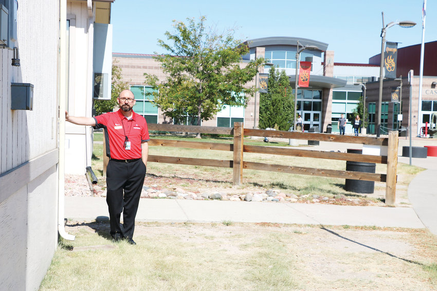 Rex Corr, principal of Castle View High School in Castle Rock, stands next to one of eight mobiles, which are structures that serve as outdoor classrooms. Funds from a bond would go towards a $25,000-square-foot addition on the school, which is well over capacity.