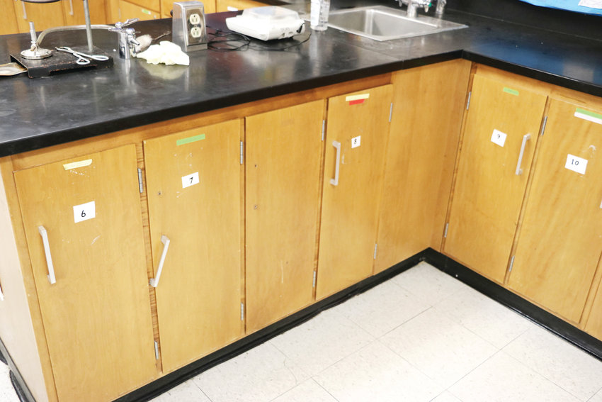 Some cabinet handles in Douglas County High School's classrooms are either broken or missing. The outdated aesthetics of the school impact students and teachers, district employees say.