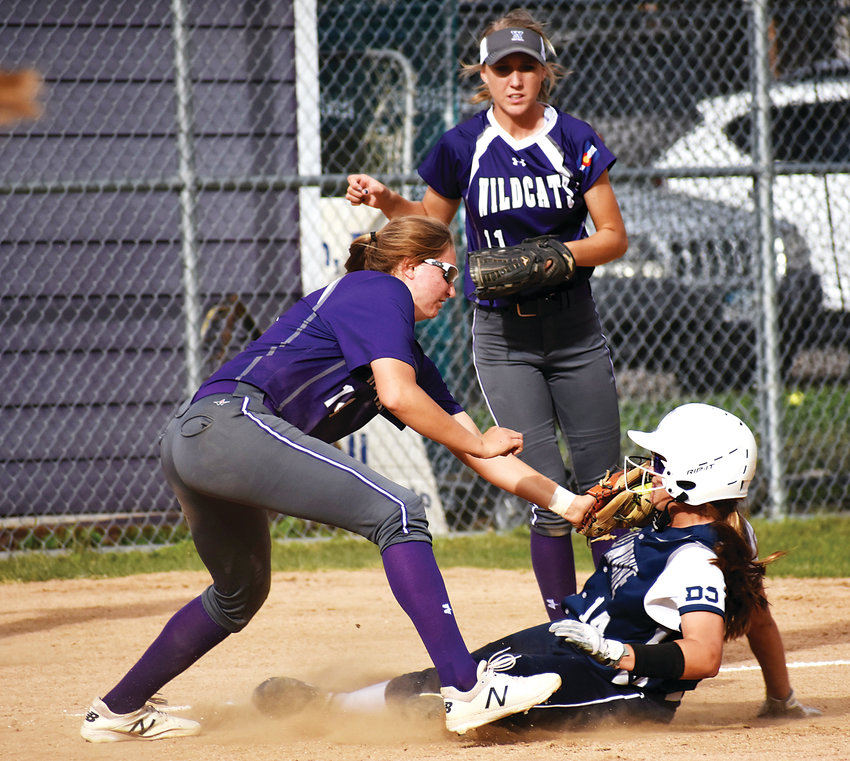 Arvada West senior Christaana Angelopulos, left, tags out Columbine freshman Emma Todd as she slides into third base Oct. 2 at Arvada West High School. The Wildcats suffered their lone conference defeat of the season, losing to the Rebels 10-3.