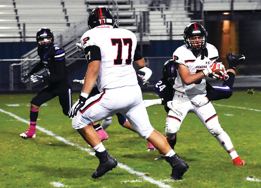Pomona senior Dominic Bettini (5) spins out of a tackle attempt by Arvada West senior Sam Bundy (24) during the second half Oct. 4 at the North Area Athletic Complex. Bettini had a monster night with 44 carries for 270 yards and five touchdowns in the Panthers' 41-27 victory.