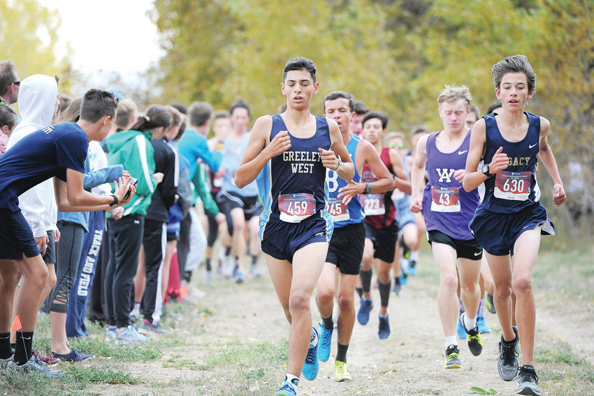 Greeley West junior Ricky Carmona, left, and Legacy freshman Michael Vrlenich, begin their second mile of the Boys Varsity race at the Pat Amato Invitational Cross Country meet Oct. 5, at Northglenn Open Space. 50 schools participated.