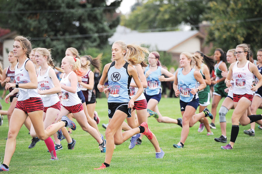 Varsity girls run from the start during last Friday's Pat Amato Classic Invitational Oct. 5 at Northglenn Open Space. Fifty schools participated in this year's annual event, named in honor of the longtime Northglenn High School coach.