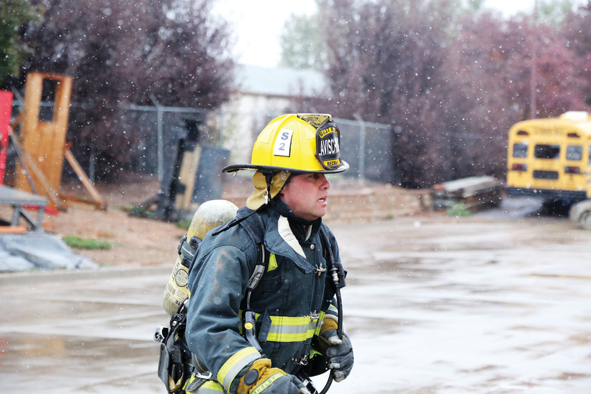 T.J. Avischious, an Arvada Fire recruit, runs a drill with teammates at the West Metro Fire Academy Oct. 10 during the first snowfall of the season in the metro area.