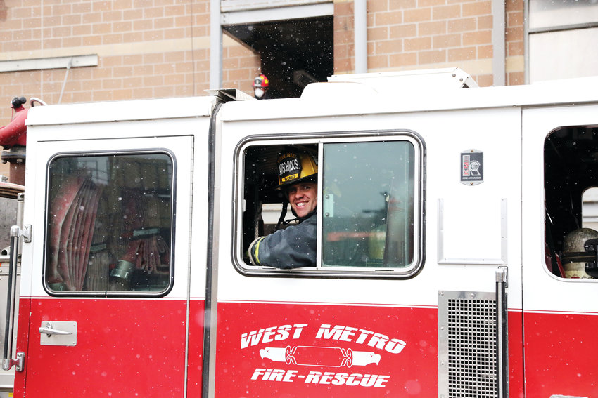 T.J. Avischious, 33, prepares to run a drill with other fire recruits at the West Metro Fire Rescue Academy.
