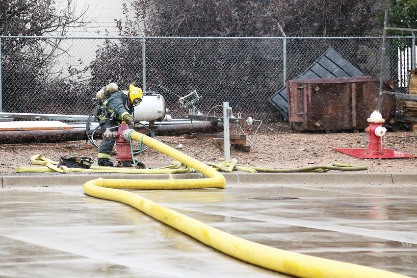 T.J. Avischious, 33, attaches a hose during a training drill at the West Metro Fire Academy.