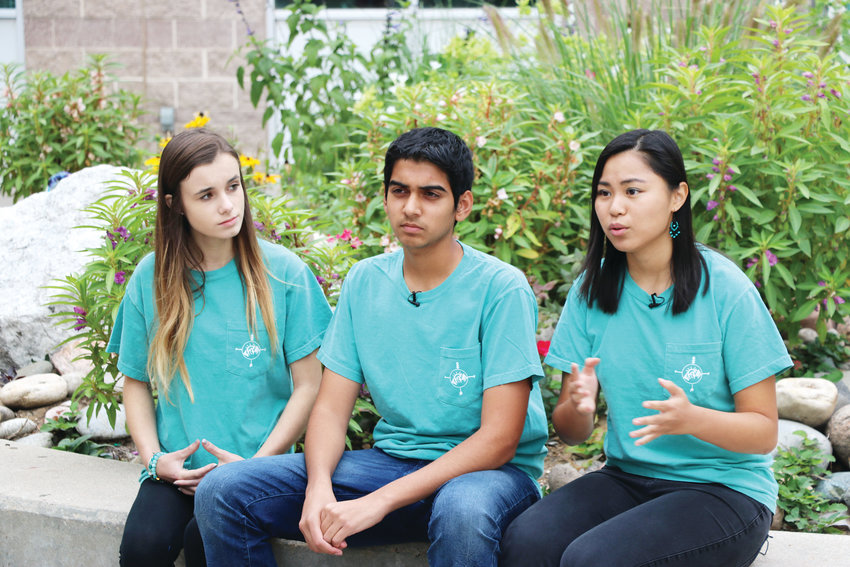 Mia Hayden, left, Rohan Nipunge and Melanie Zhou talk about their up-and-coming nonprofit organization, Oasis. The three ThunderRidge High School students want to change how students and staff view mental health.