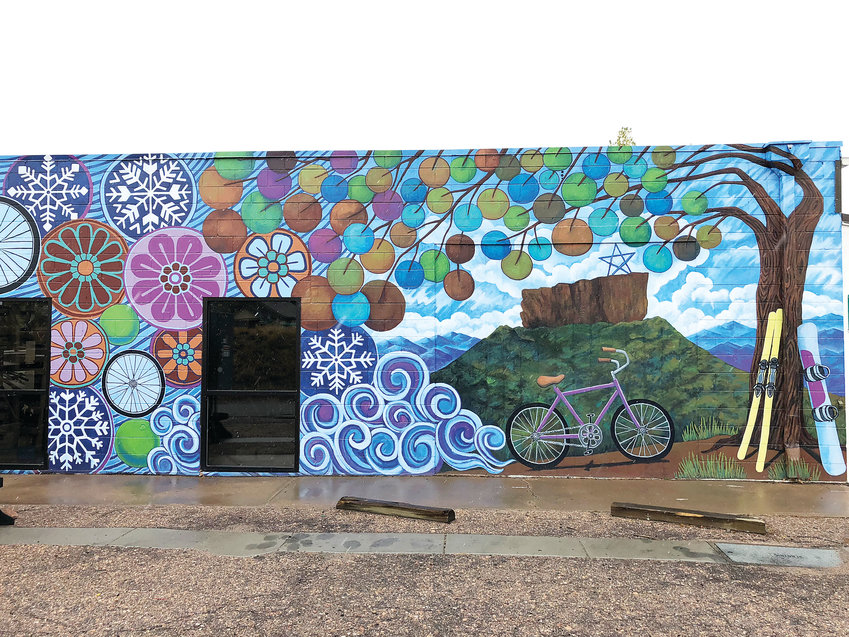 A mural on the side of Castle Rock Bike & Ski adds funky and cool public art in the downtown district, said K.C. Neel, who runs the shop with her husband.