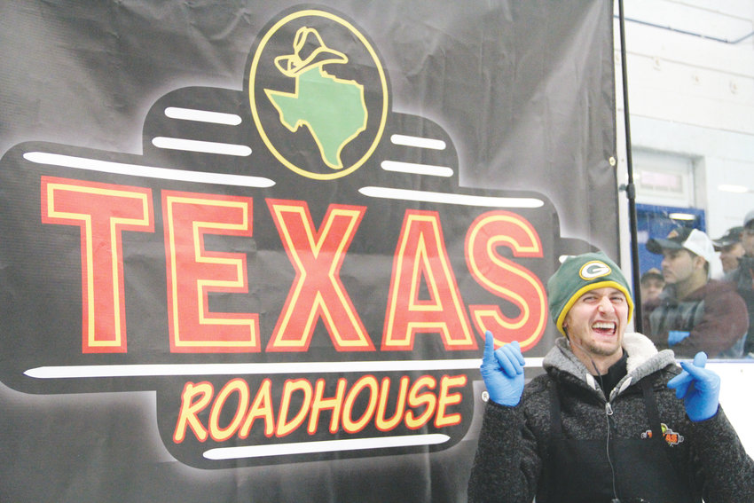 Nathan Garness, 29, poses in front of the Texas Roadhouse banner Oct. 8 at South Suburban Ice Arena. The ice rink at 6580 S. Vine St. in Centennial hosted a qualifier in the 2018 Meat Cutting Challenge for meat cutters who work at the restaurant.