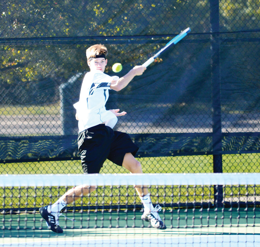 Arapahoe senior Tyler Landen eyes his backhand return as he avenged an early-season loss to Cherry Creek's George Cavo with a 6-3, 6-3 win in the No. 1 singles third-place match on Oct. 13 at the 5A state tennis tournament at the Gates Tennis Center in Denver.
