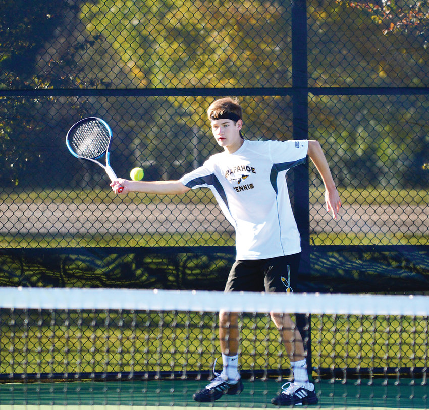 Arapahoe senior Tyler Landen hits a forehand return as he avenged an early-season loss to Cherry Creek's George Cavo with a 6-3, 6-3 win in the No. 1 singles third-place match on Oct. 13 at the 5A state tennis tournament at the Gates Tennis Center in Denver.