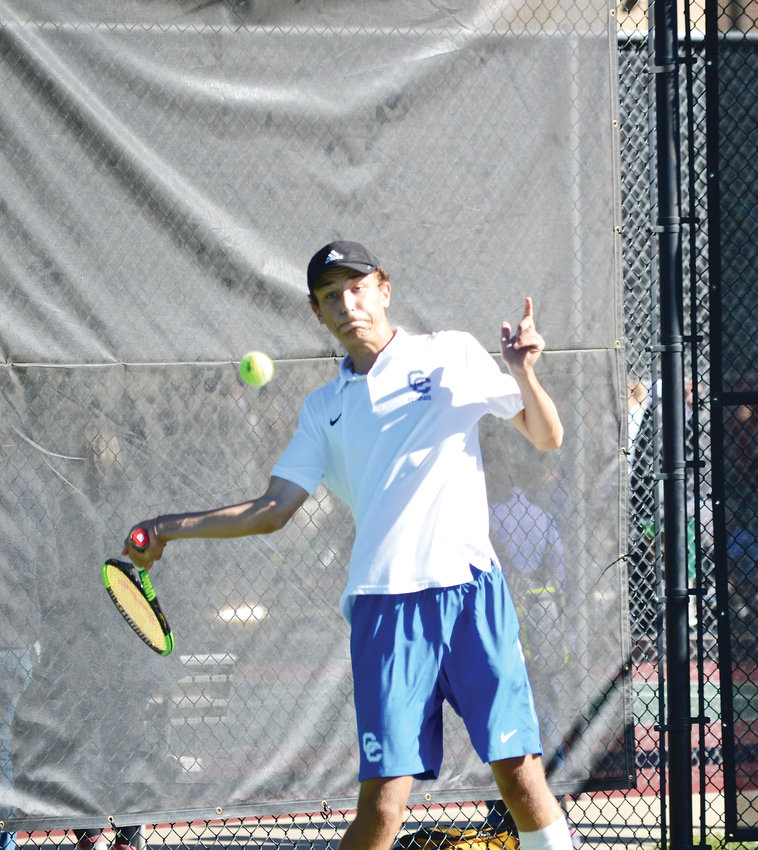 Cherry Creek junior Nick Svichar hits a forehand return in his third place, No. 2 singles match on Oct. 12 at the 5A state tournament at the Gates Tennis Center. Svichar defeated Boulder's Alex McCoy, 6-4, 7-6.