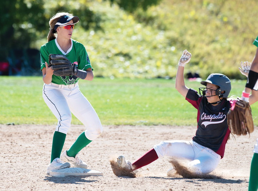 ThunderRidge's Brooke Ballard (11) gets the tag as Chatfield's Peyton Shepard attempts the slide at second base. The Grizzlies dropped the first game of 5A Region 2 Playoff to Valor Christian 12-2 and then lost to Chatfield 8-3 Saturday at Northridge Park.