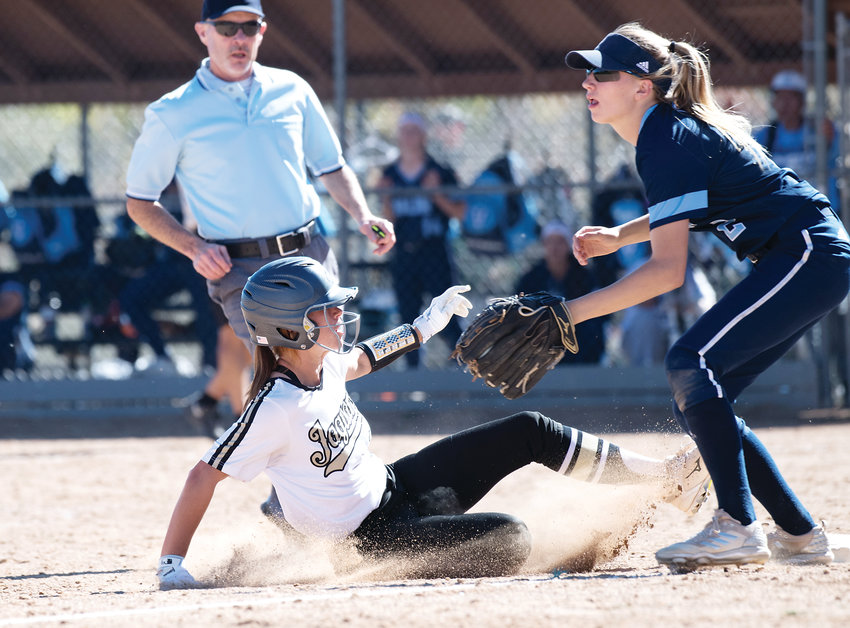 Rock Canyon's Erin Keen (11) slides safely to third base as Valor Christian's Eden McNally (2) waits for the incoming throw in their Round 2 game of the Regional Softball playoffs. The Jaguars took 1st place in 5A region 2 Saturday at Northridge Park by the score of 11-3. The Jaguars also defeated Chatfield 6-1 in the earlier game.