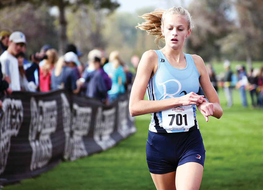 Ralston Valley sophomore Rachel Meeks finishes fifth during the Class 5A girls race at the Jeffco League cross country championships Thursday, Oct. 11, at Clement Park. The Mustangs finished third in the team race behind Valor Christian and Arvada West.