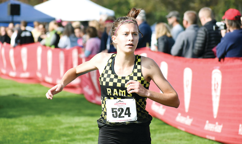Green Mountain junior Kasey Klocek crosses the finish line in third place during the Class 4A girls race at the Jeffco League cross country championships Thursday, Oct. 11, at Clement Park. The Rams finished second in the team race, just one point behind D'Evelyn.