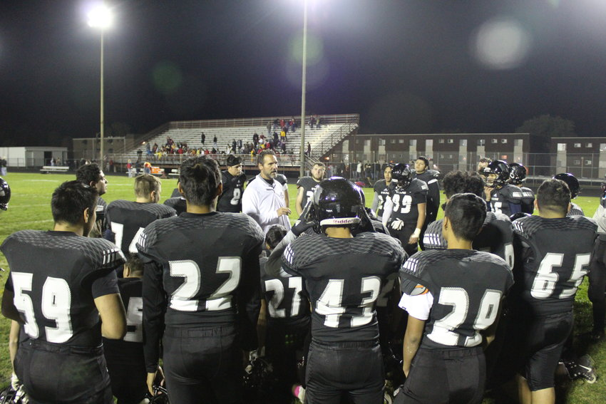 Westminster Football Coach Kerry Denison talks to his team after their 35-12 victory at home over Northglenn Oct. 12.