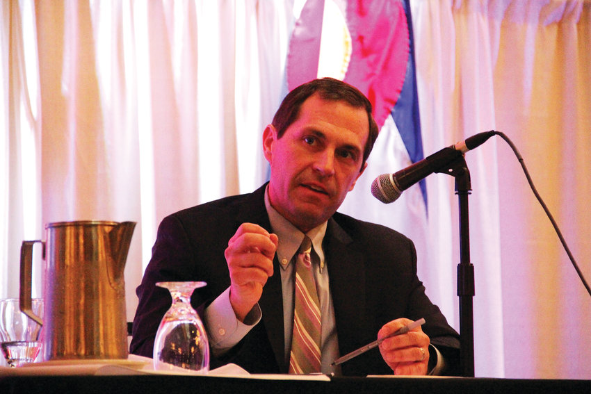 Democratic challenger Jason Crow speaks Oct. 17 at a candidates' forum hosted by the Aurora Chamber of Commerce and the Aurora Association of Realtors at the Radisson Hotel in Aurora.