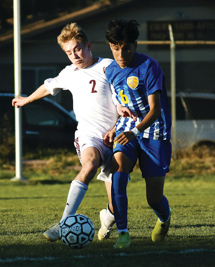 Golden junior Nate Thompson (2) battles with Wheat Ridge sophomore Ricardo Hernandez (6) near midfield Tuesday, Oct. 16, at Lakewood Memorial Field.
