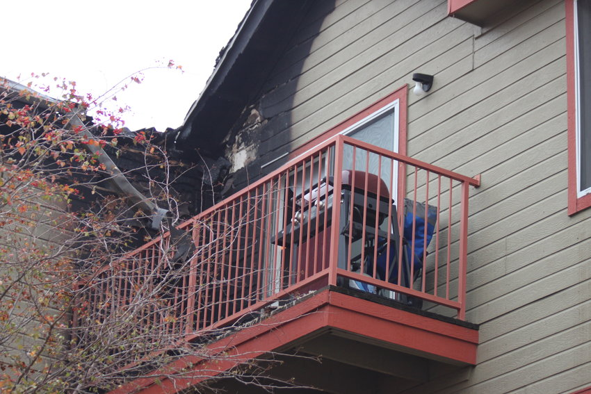 Fire damage is evident on a third-floor balcony at the South Creek Apartments. A resident said she believed the balcony was the source of the fire, which was ruled accidental.