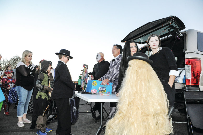 Area youngsters receive candy from Harmes Team Real Estate associates of Broomfield, during Thornton's annual Trunk-or-Treat Oct. 20 at Carpenter Park.