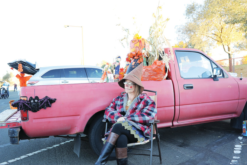 "Lori Lloyd of Thornton, awaits visitors to her pickup's entry, ""Pumpkin Patch"", at this year's Thornton Trunk-or-Treat extravaganza Oct. 20 at Carpenter Park."