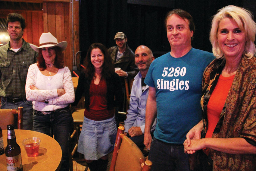 Second from right, Craig Barber, a Littleton-area resident who runs meetups — group activities organized online — stands with people at a country dance-themed event he hosted at Stampede bar and dance club in Aurora Oct. 26. Celeste Tarantola, an Arvada resident, stood in the cowboy hat.