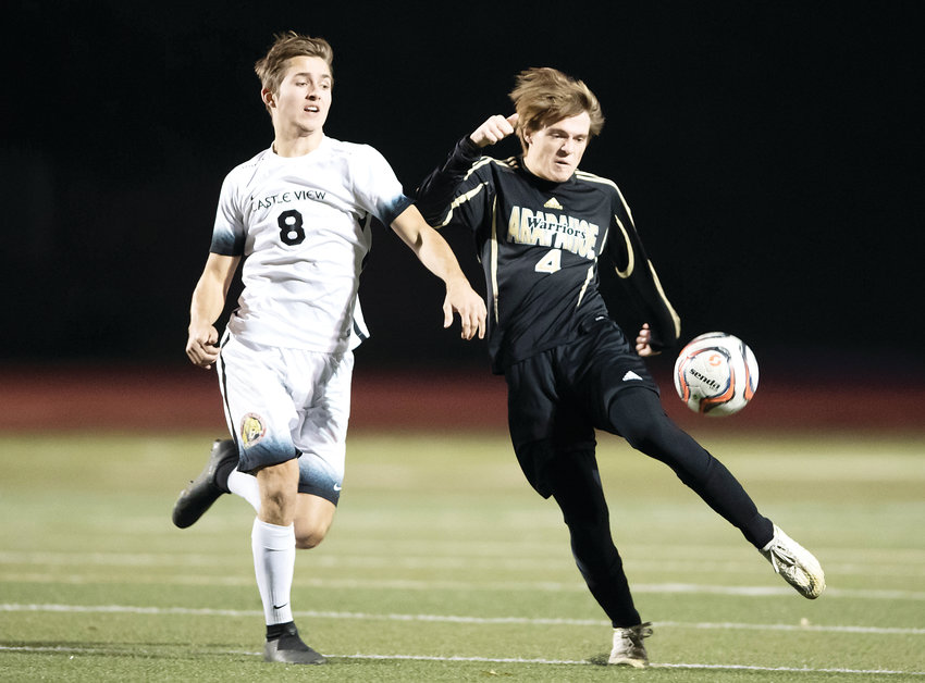 Arapahoe's Zach Miller, right, takes the incoming ball to keep away from approaching Castle View player Ryan Hannigan on Oct. 25. Arapahoe ended up with a 3-0 win in the first round of the 5A playoffs.