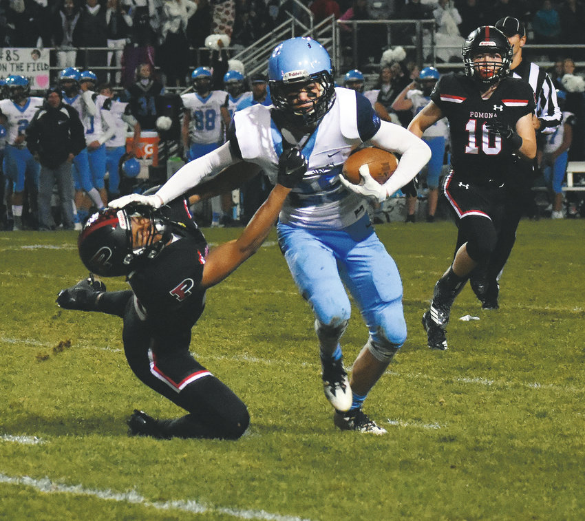 Ralston Valley senior Karsten Barndt, right, stiff arms Pomona senior David Ross after an interception in the first half Oct. 26 at the North Area Athletic Complex. Ralston Valley defeated Pomona 38-26 to close out the regular season. It was the first win for the Mustangs over the Panthers since 2014.