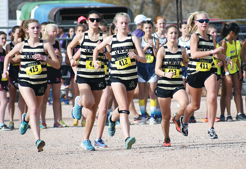 Jefferson Academy's girls cross country team warms up before the start of the Class 3A state championship race Oct. 27 at Norris-Penrose Event Center in Colorado Springs. Sophomore Jocey Farhar (409) had the top individual finish for the Jaguars placing 84th.