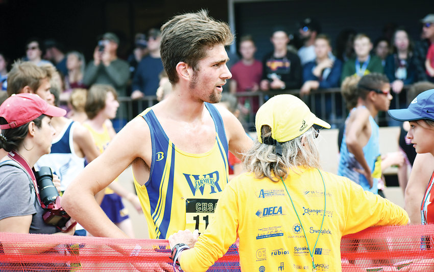 Wheat Ridge senior Rory Seidel, left, talks with Farmers' cross country coach Judy Chamberlin after Seidel placed 25th in the Class 4A boys state championship race Oct. 27 in Colorado Springs.