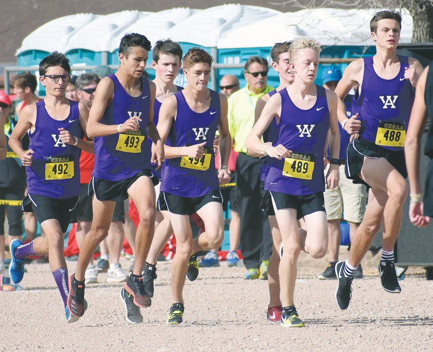 Arvada West's boys cross country team warms up during run outs before the start of the Class 5A boys race during the cross country state championships Oct. 27 in Colorado Springs. The Wildcats finished 18th in the team standings.