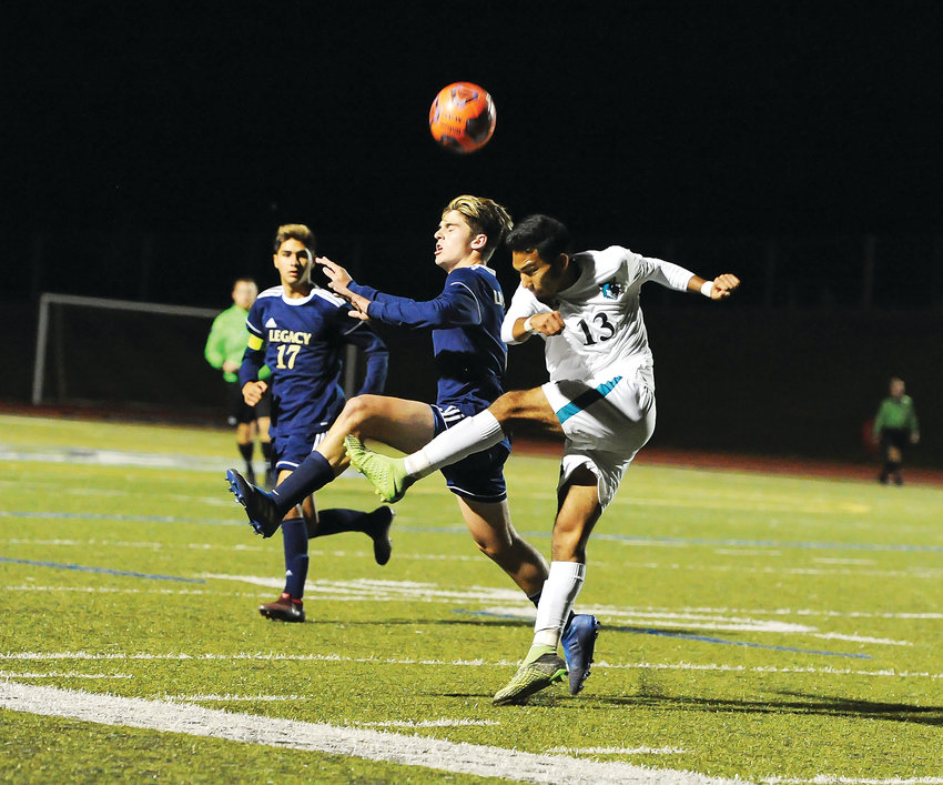 Legacy midfielder Ryan Bennett, left, battles with Westminster's Jesus Hernandez, during first half action of the CHSAA opening round 5A playoff game Oct. 25 at District 12 North Stadium. The Lightning edged the Wolves, 1-0.