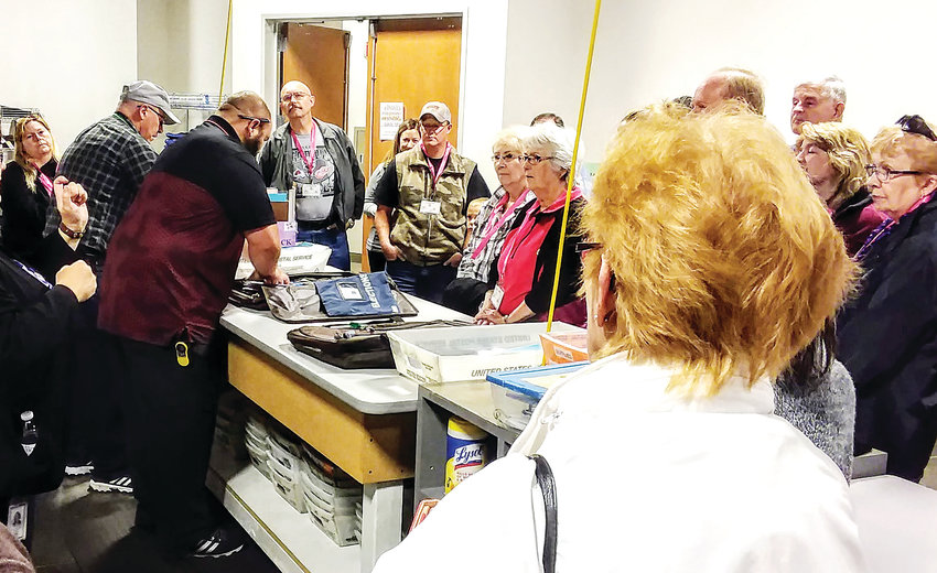An election judge opens a ballot delivery bag for a group Nov. 1 in the Adams County Clerk's ballot counting center in Brighton. The clerk's office invited a group of 25 residents to tour the center and to show how their ballots are counted.