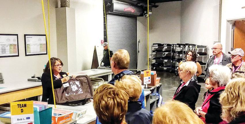 Deputy County Clerk Cristi Coburn explains to a tour group how ballots are delivered to the county in advance of the Nov. 6 general election. The county hosted the tour Nov. 1 to show residents how their ballots are secured and counted.