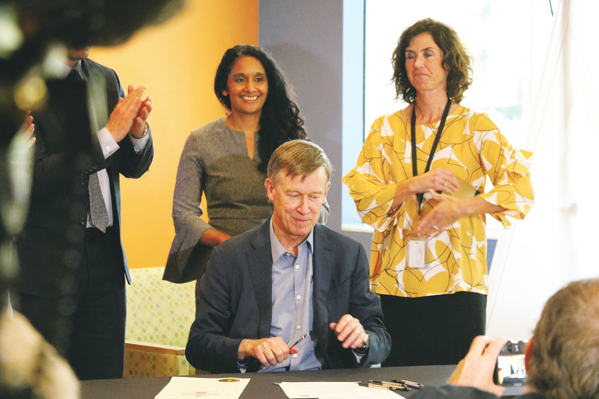 Gov. John Hickenlooper signs an executive order to curb teen vaping at a press conference at Children's Hospital Colorado on Nov. 2.