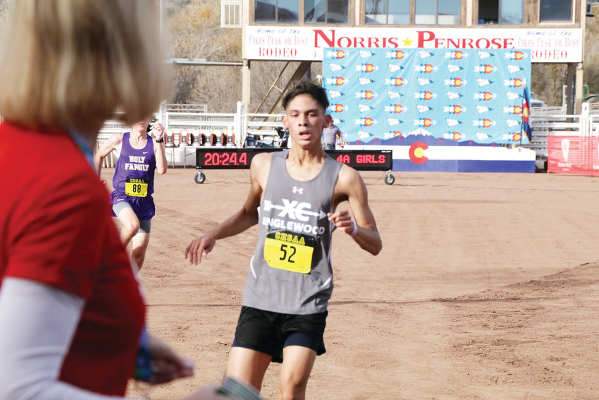 Englewood senior Dylan Carpenter crosses the finish line at the Oct. 27 Class 3A state cross country meet. Carpenter finished in 157th place with a time of 20:24. His effort helped the Pirates finish 19th in the team standings in the field of 20 teams.