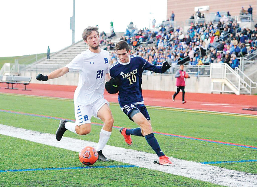 Broomfield's Sean O'Brien battles  with Legacy's Noah Stover, during first half action of the Nov. 3 CHSAA 5A playoff  game at District 12 North Stadium. The visiting Eagles beat the Lightning, 2-1 in double overtime.