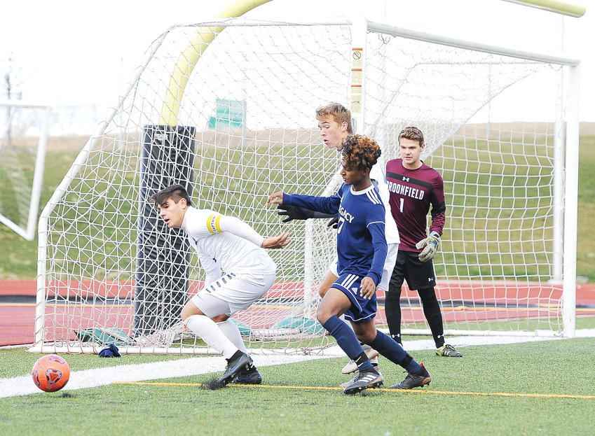 Legacy's Gustavo Guiterrez is squeezed off the ball by Broomfield's Andres Ocampo, left, and Joey Iacovetta, as the Eagles' goalkeeper Kaden Carson looks on, during 2nd half action of the CHSAA 5A quarterfinal playoff game at District 12 North Stadium Nov. 3. Broomfield bested the Lighting, 2-1, in double OT.