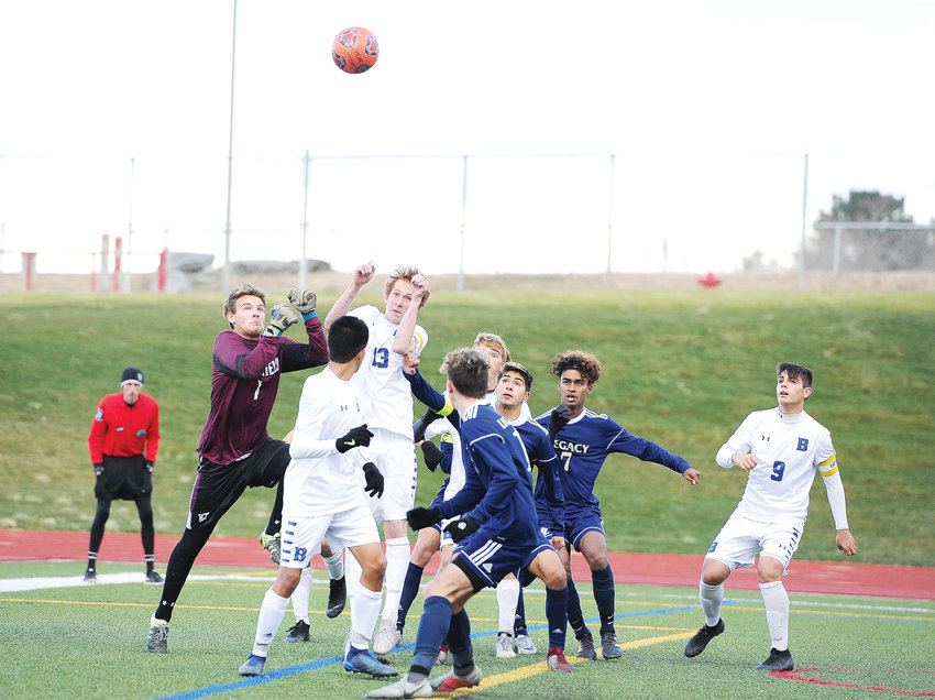 Broomfield goalkeeper Kaden Carson, left, prepares to punch the ball away from a group of players, after a Legacy corner kick, during the 2nd half of a CHSAA 5A quarterfinal playoff game at District 12 North Stadium Nov. 3. The Eagles needed two overtimes to edge the Lightning, 2-1, ending Legacy's 2018 playoff run.