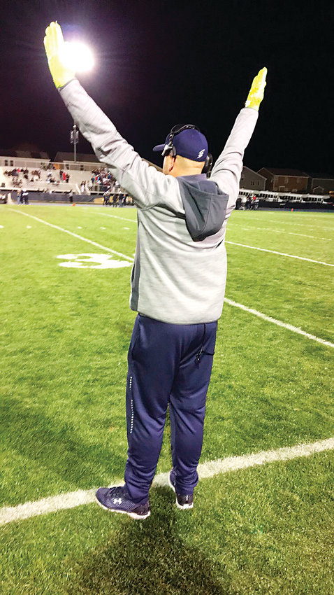 Legacy assistant coach Kyle Rider celebrates the clinching first down for the win over Mullen Nov. 2 in the first round of the 5A state playoffs.