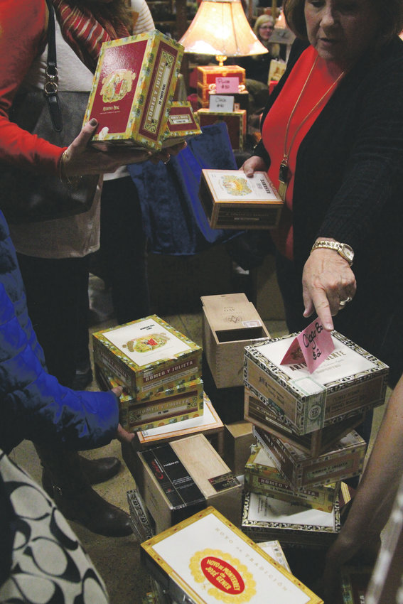Cigar boxes on sale for $2 created a frenzy at one vendor's stand.