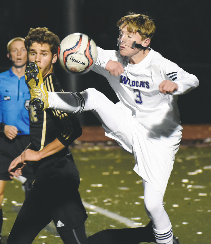 Arvada West sophomore Noah Kanagy (3) gets his foot on the ball in front of Arapahoe senior Zander Hahn during the Class 5A second-round state playoff game Halloween night at Littleton Public Schools Stadium. A-West had its season come to an end with a 1-0 loss.