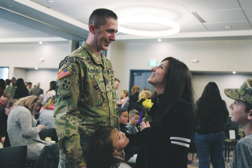 1st Sgt. Ben Prebble, of Northglenn, spends time with his wife, Cimonne and children Cienna and Kyle, following a deployment ceremony for the  soldiers and families of the U.S. Army Reserve 98th Signal Battalion held Nov. 4 at Origin Hotel.